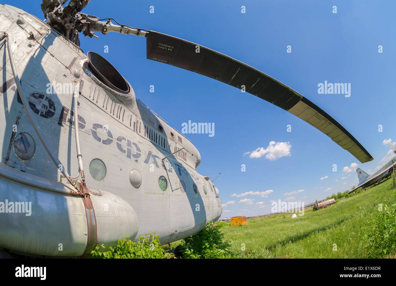 The russian heavy transport helicopter Mi-6 at an abandoned aerodrome. The Mil Mi-6 was built in large numbers for - Stock Image