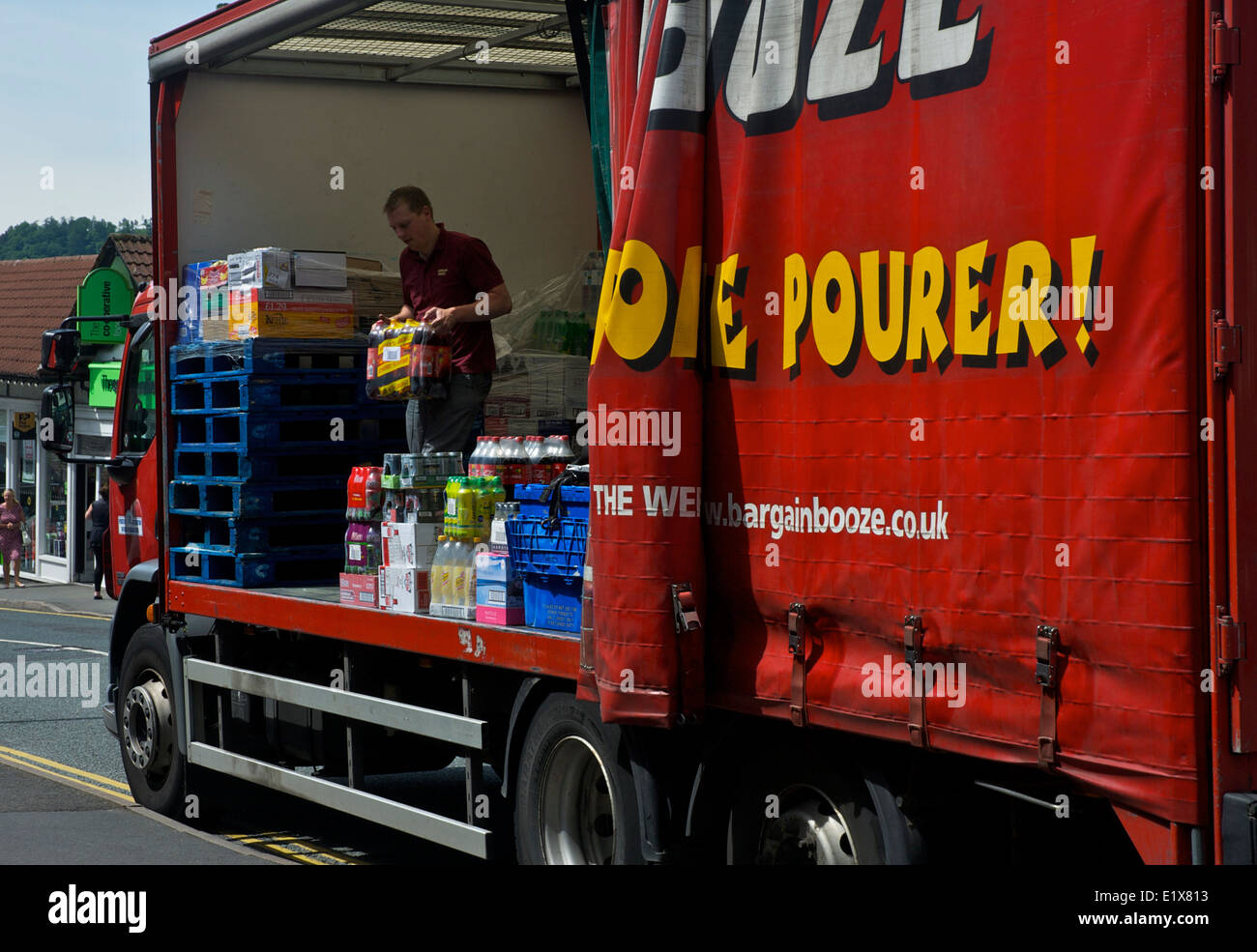 Man unloading Bargain Booze delivery lorry, Bowness, Lake District National Park, Cumbria, England UK - Stock Image
