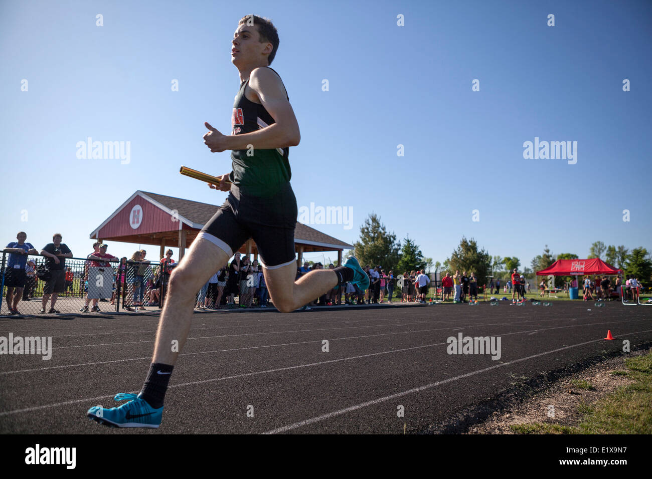 High school athletes compete in a track and filed meet in Milwaukee, Wisconsin, USA. - Stock Image