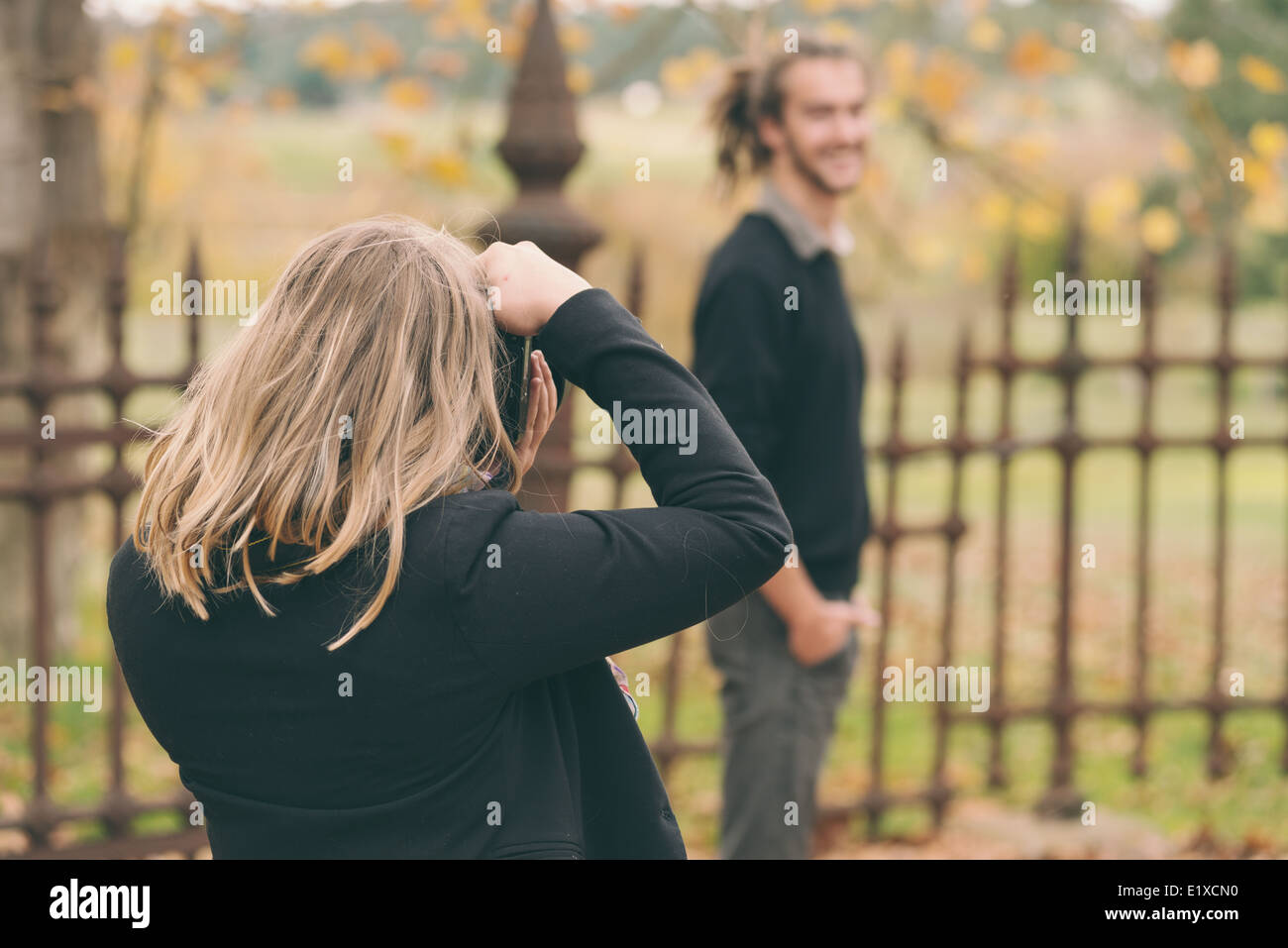young man being photographed - Stock Image