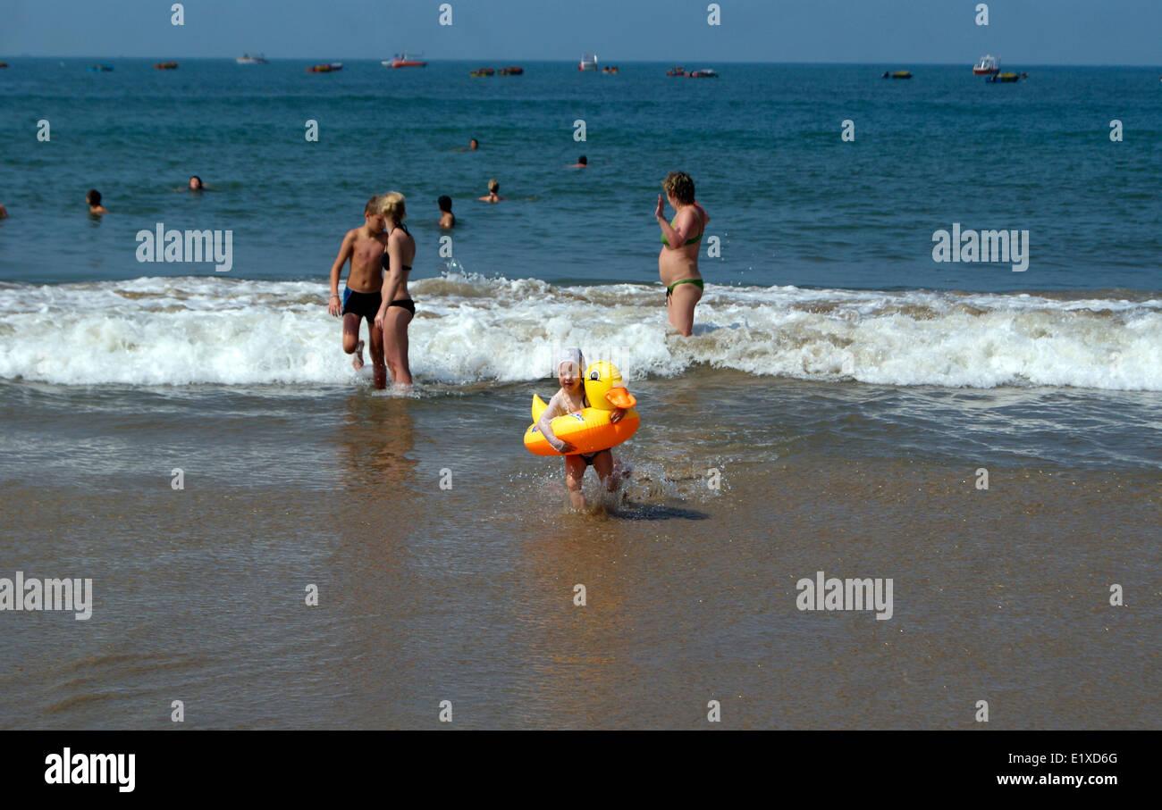 Foreign Tourists and Funny Child Enjoying the Baga Beach Goa Beaches