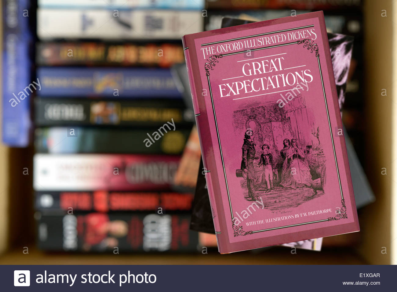 Charles Dickens novel, Great Expectations, hardback title stacked used books, England - Stock Image