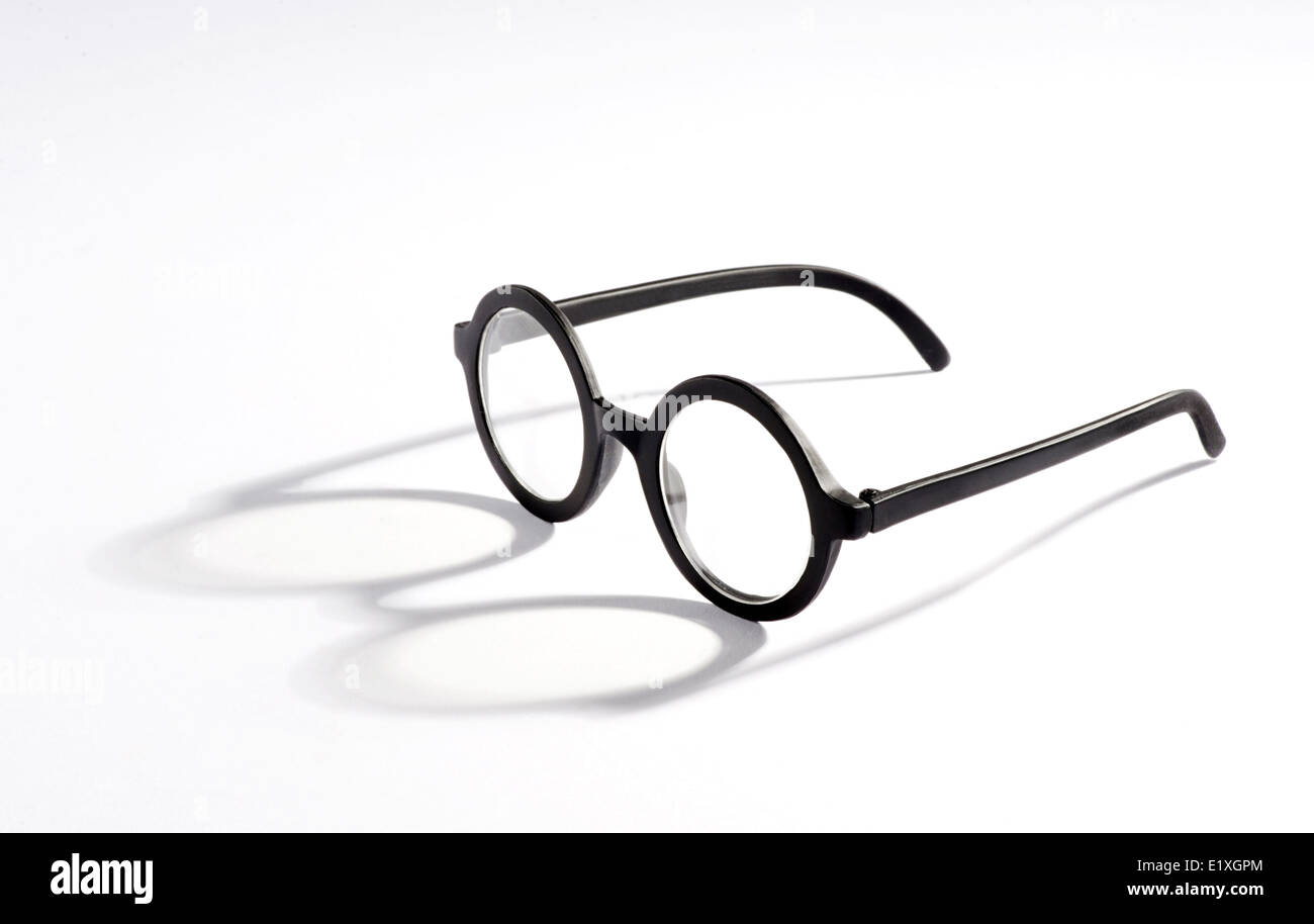 Vintage spectacles on a white background - Stock Image