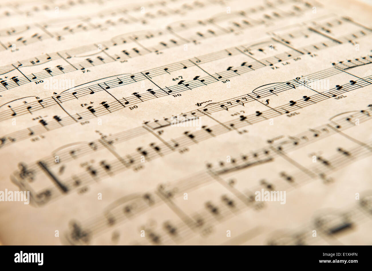 Low angle view of an old yellowed aged music score - Stock Image
