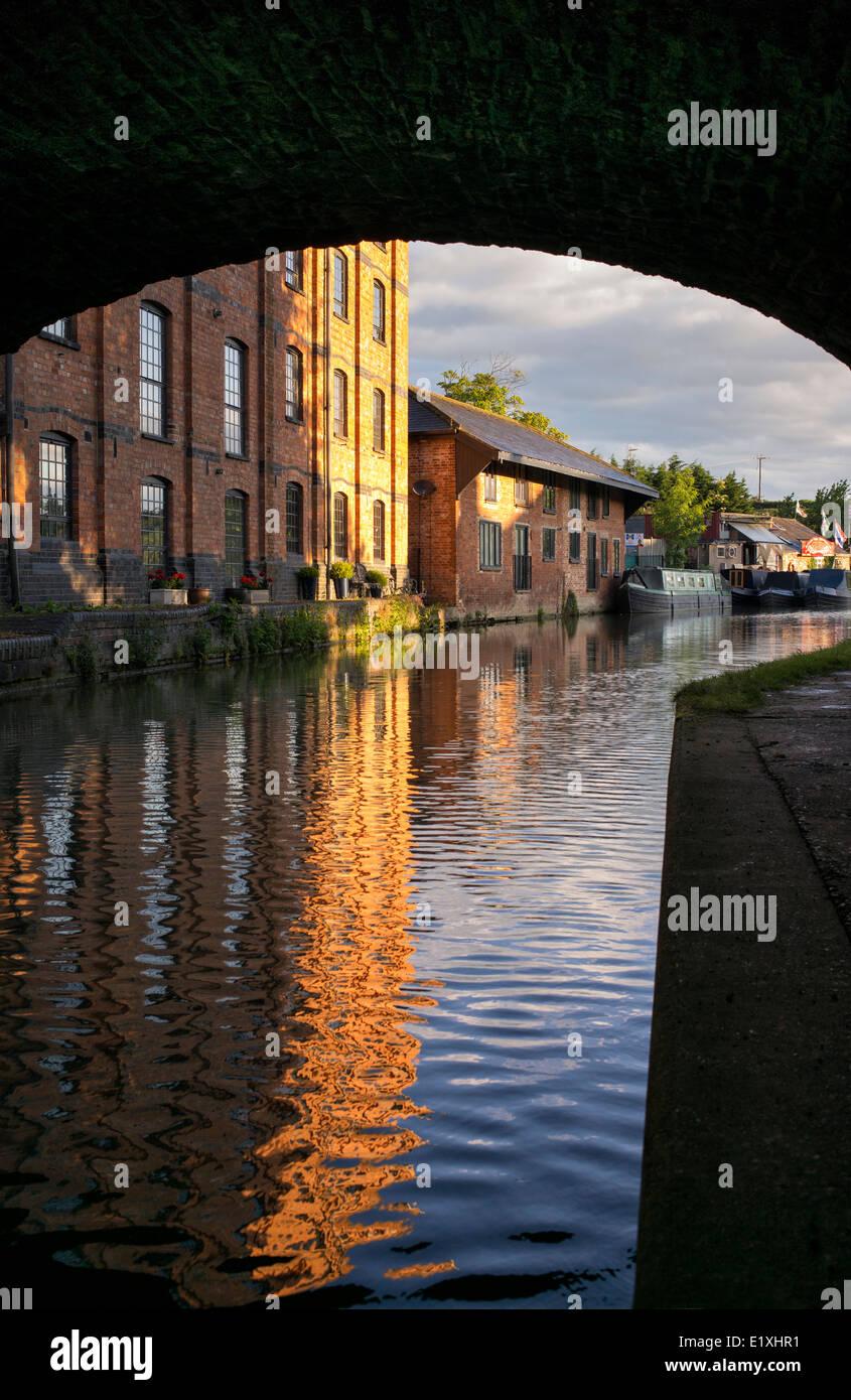 Blisworth Corn Mill and narrowboats on the Grand Union Canal at sunrise. Blisworth, Northamptonshire, England - Stock Image