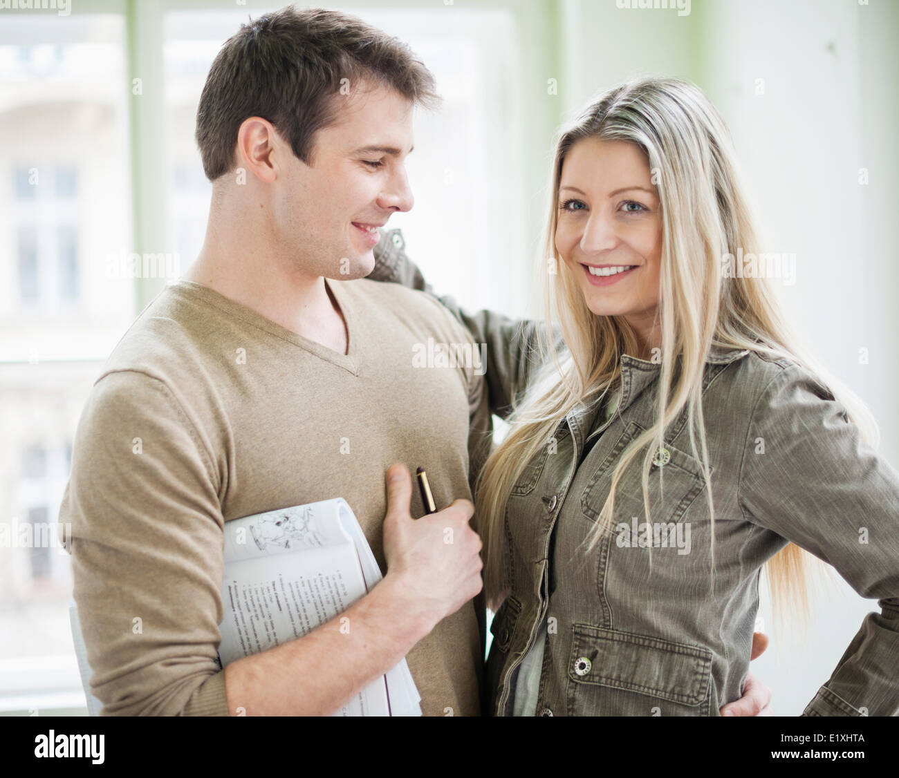 Loving business couple in office - Stock Image