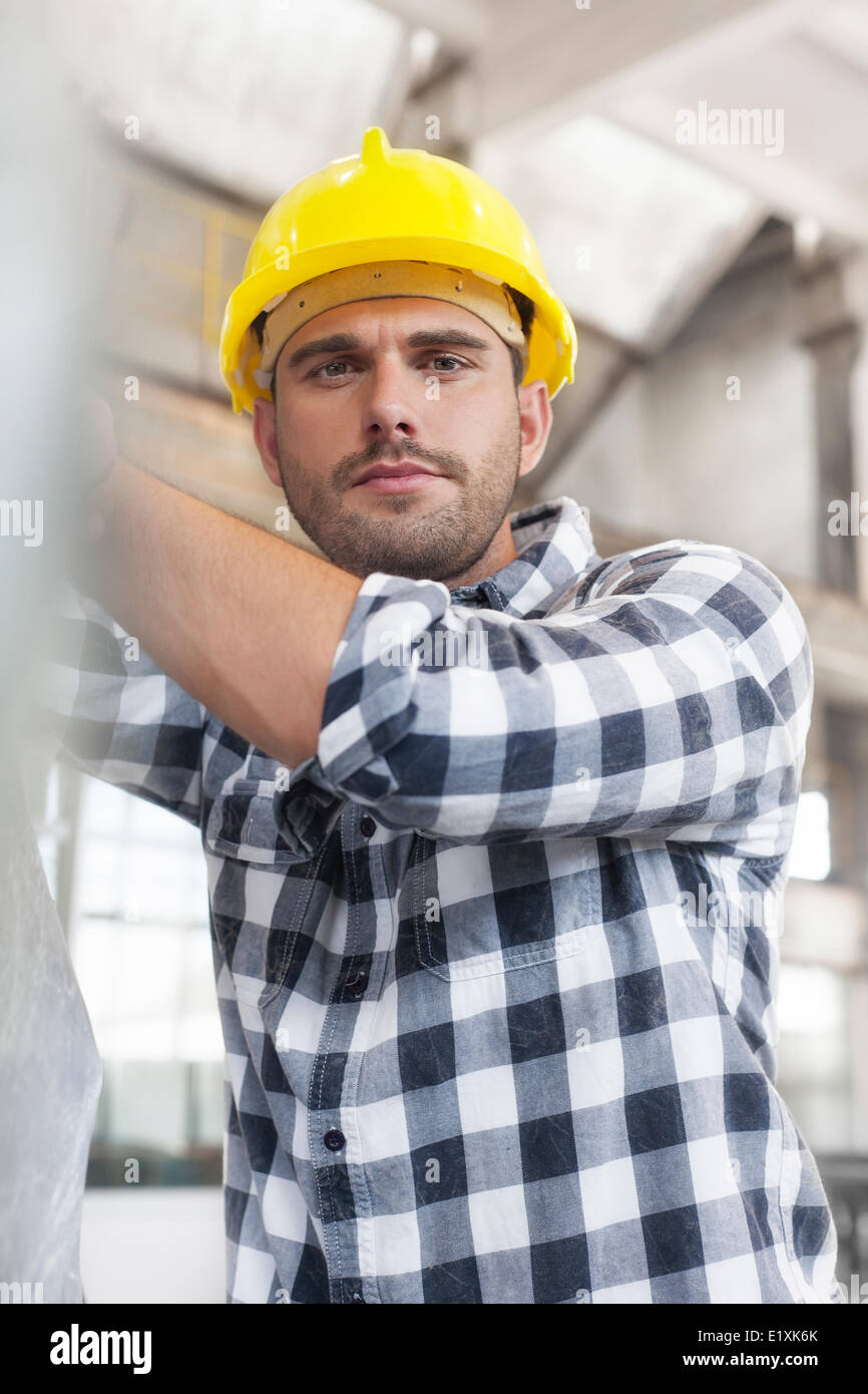 Portrait of manual worker working in industry - Stock Image