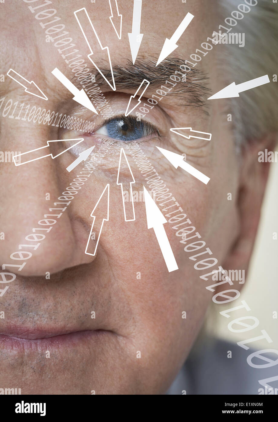 Close-up portrait of businessman with binary digits and arrow signs moving towards his eye - Stock Image