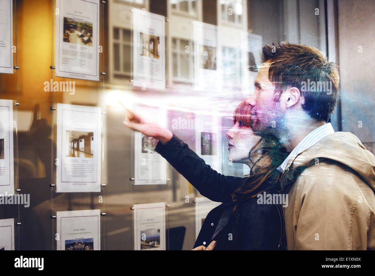 Couple discussing over travel pictures - Stock Image