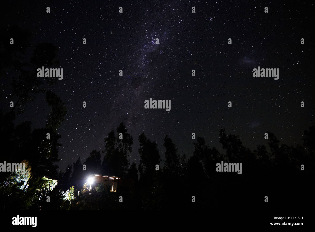 milky way and stars in the sky over woods in los pellines chile - Stock Image