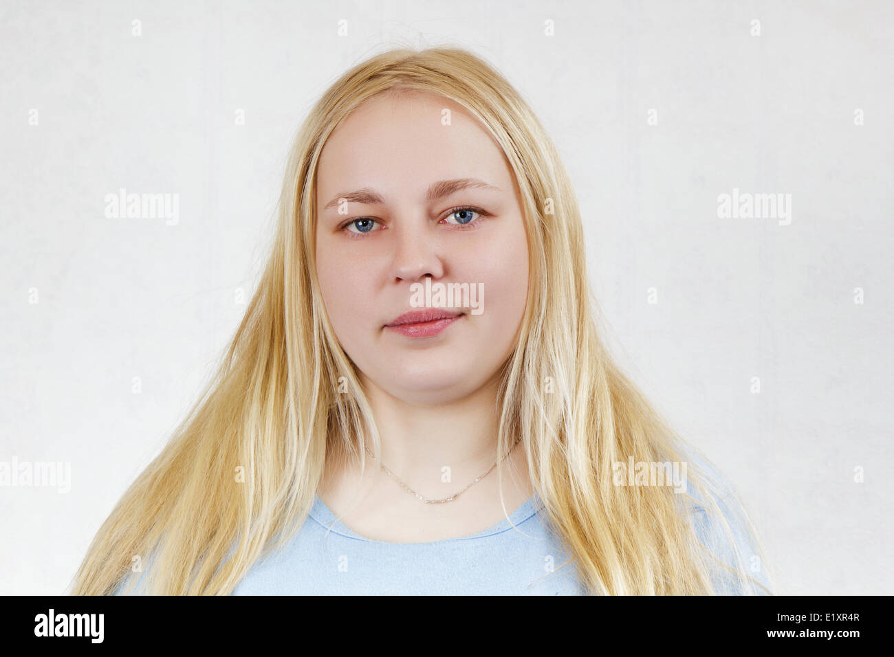 chubby blonde girl - Stock Image