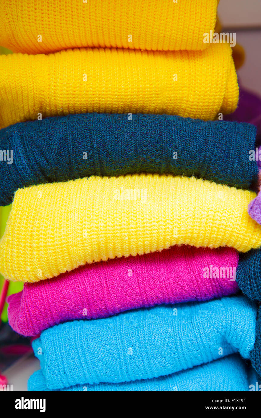 pile of bright colored tights for children - Stock Image