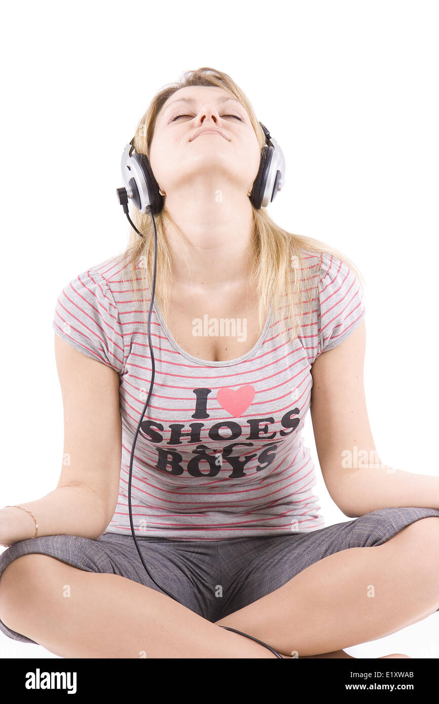 The girl listens to music - Stock Image