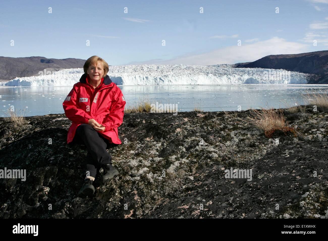 Chancellor Angela Merkel (CDU) sits at the Eqi glacier near Ilulissat in Greenland (17.08.2007). Foto: Michael KappelerStock Photo
