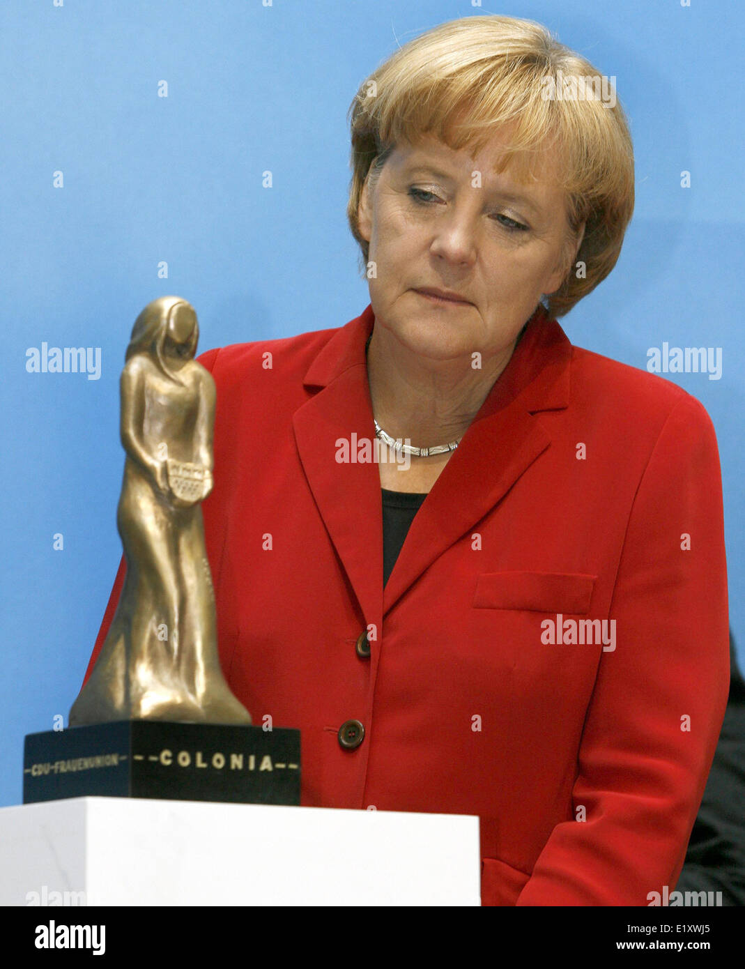 Chancellor Angela Merkel (CDU) looks at the 'Colonia' the women's award of the women's union Cologne. - Stock Image
