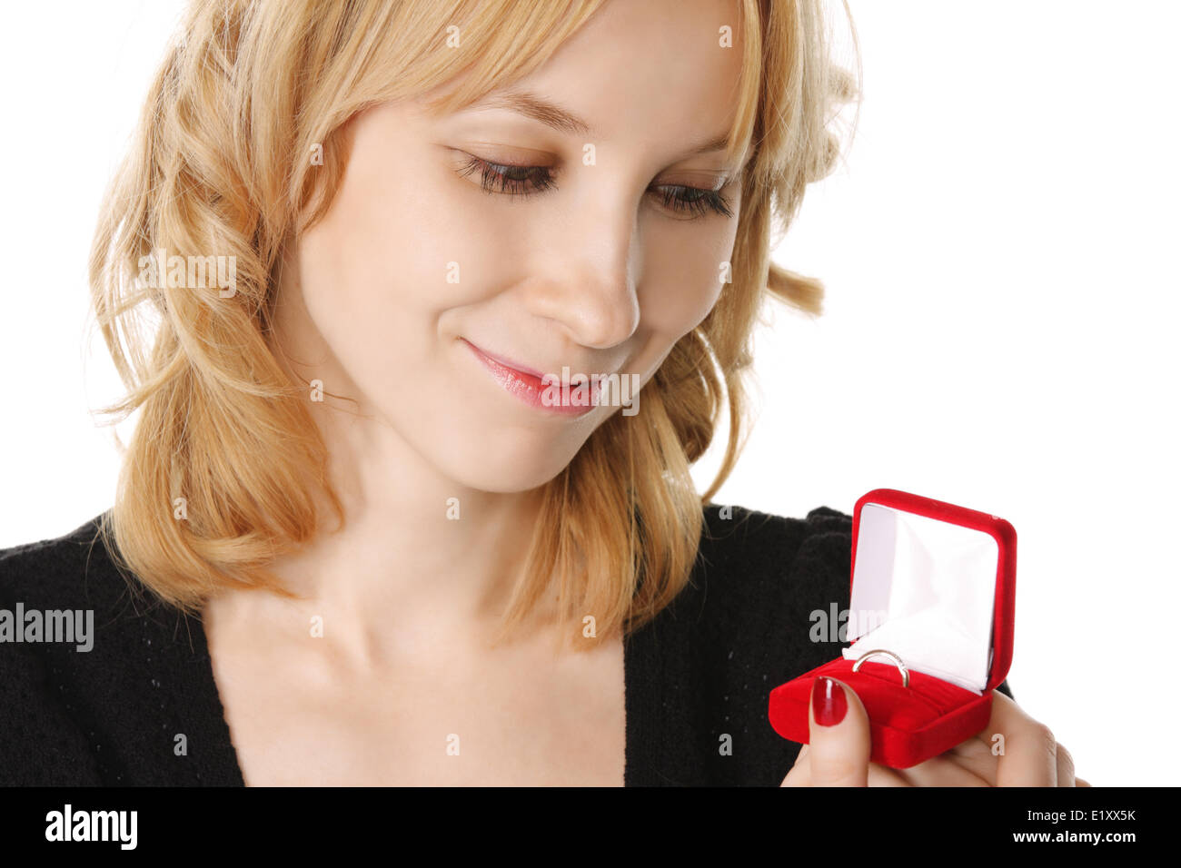 Ring in blondes hand - Stock Image