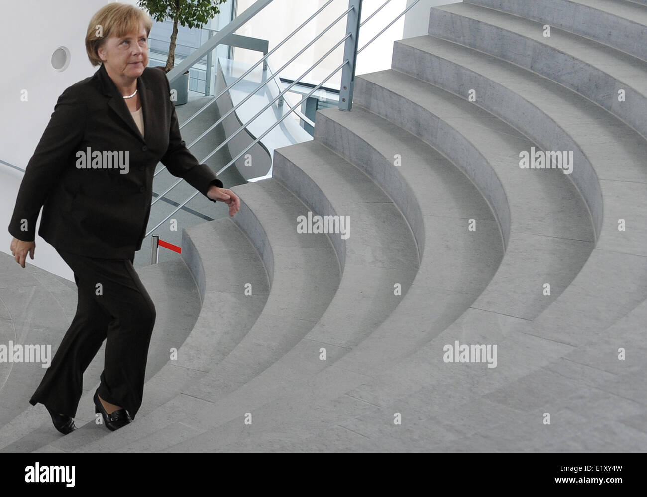 After a meeting with potential sponsors for the Winter Olympics 2018, Angela Merkel walks through the Federal Chancellor's - Stock Image