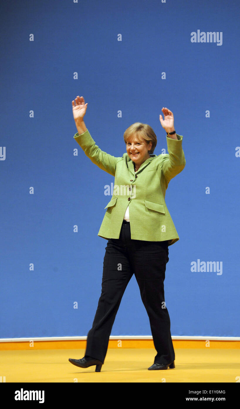 Chair woman of CDU and chancellor Angela Merkel waves and thanks the audience for the continuous applause after - Stock Image