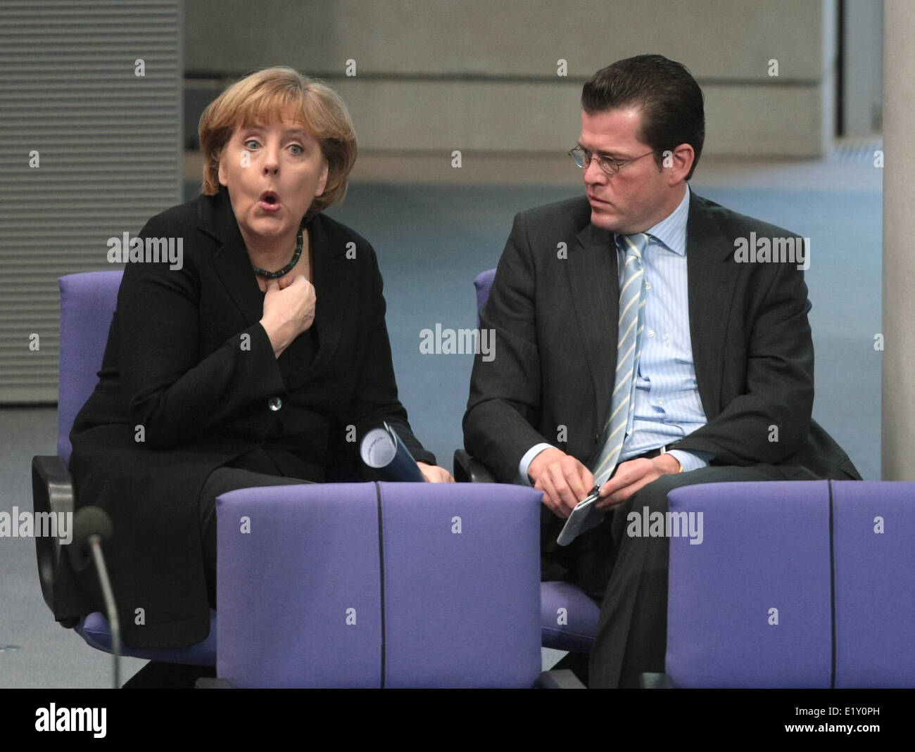 Chancellor Angela Merkel (CDU) talks to Federal minister of economics Karl-Theodor zu Guttenberg (19.03.2009). Foto: - Stock Image