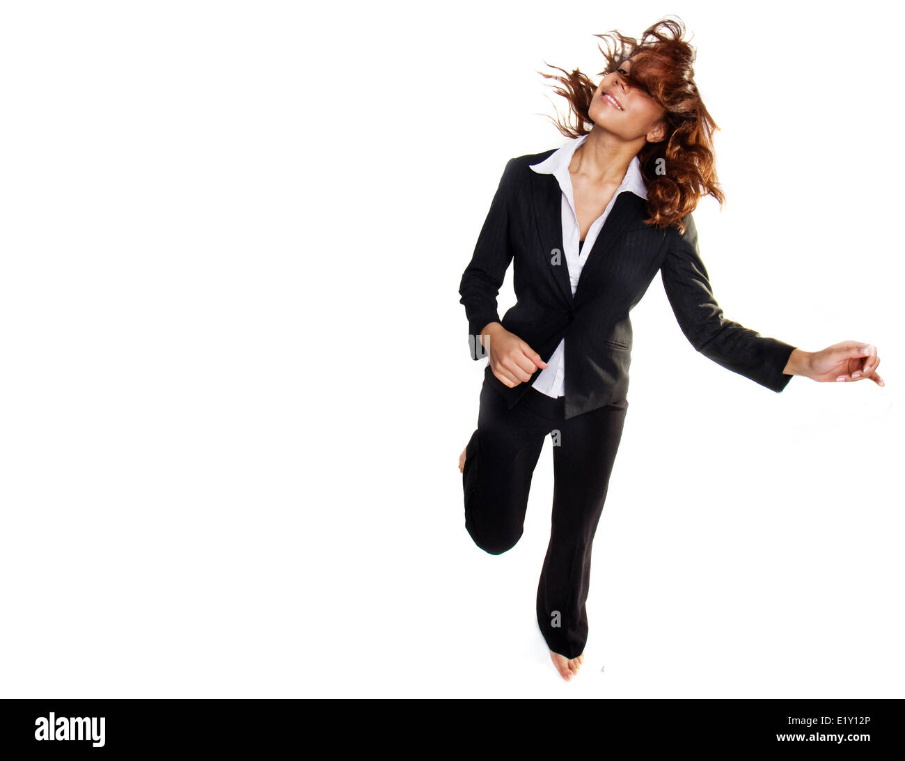 bussiness woman jumping - Stock Image