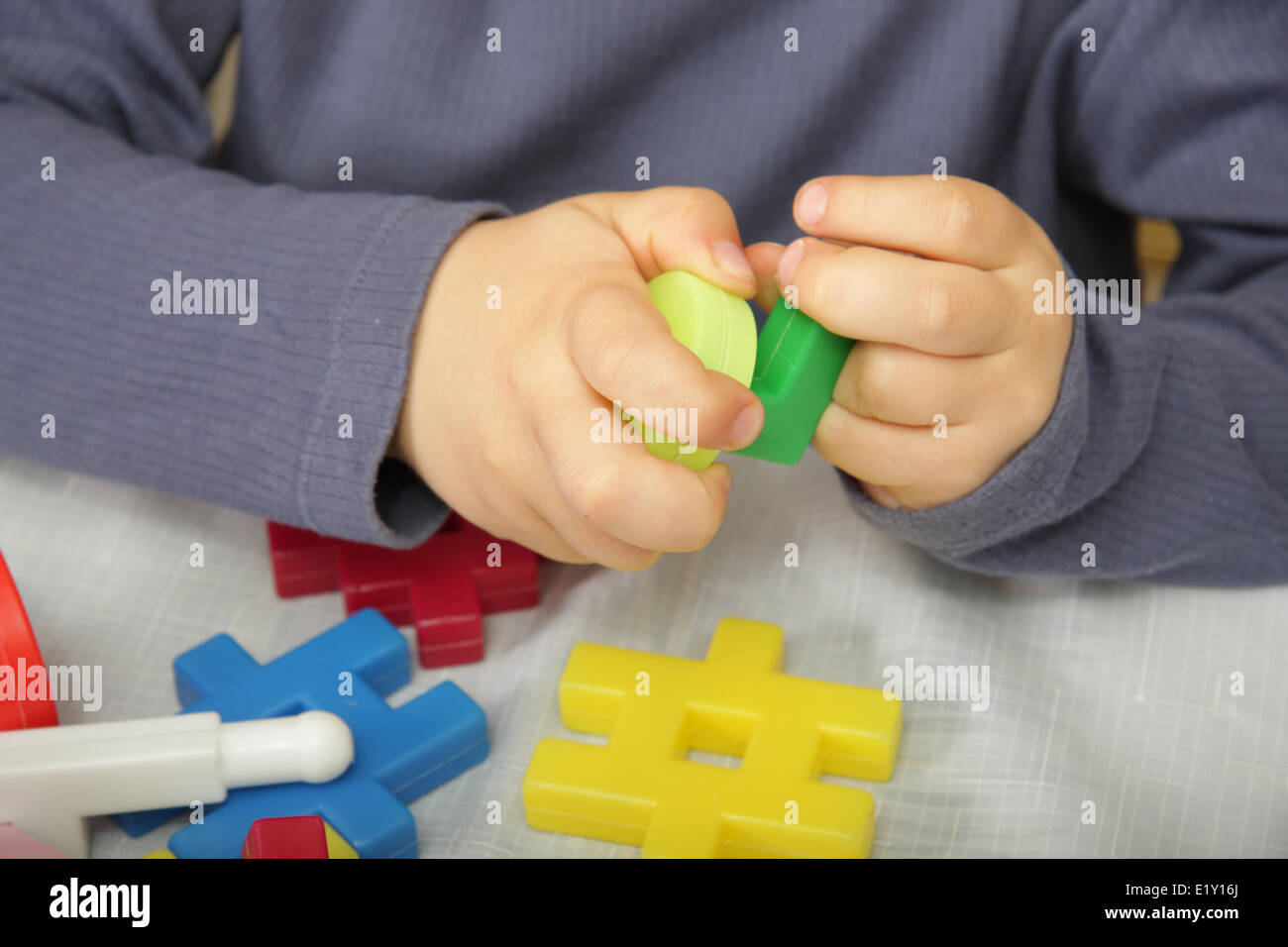 Little constructor hands - Stock Image