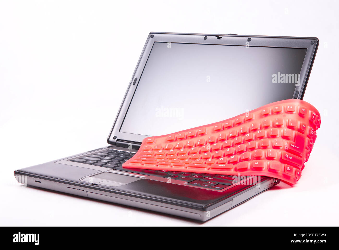 laptop and flexible magenta keyboard Stock Photo