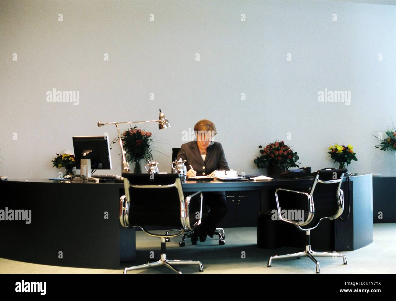 Chancellor Angela Merkel (CDU) sits at her desk in the Federal Chancellor's Office during an interview with - Stock Image
