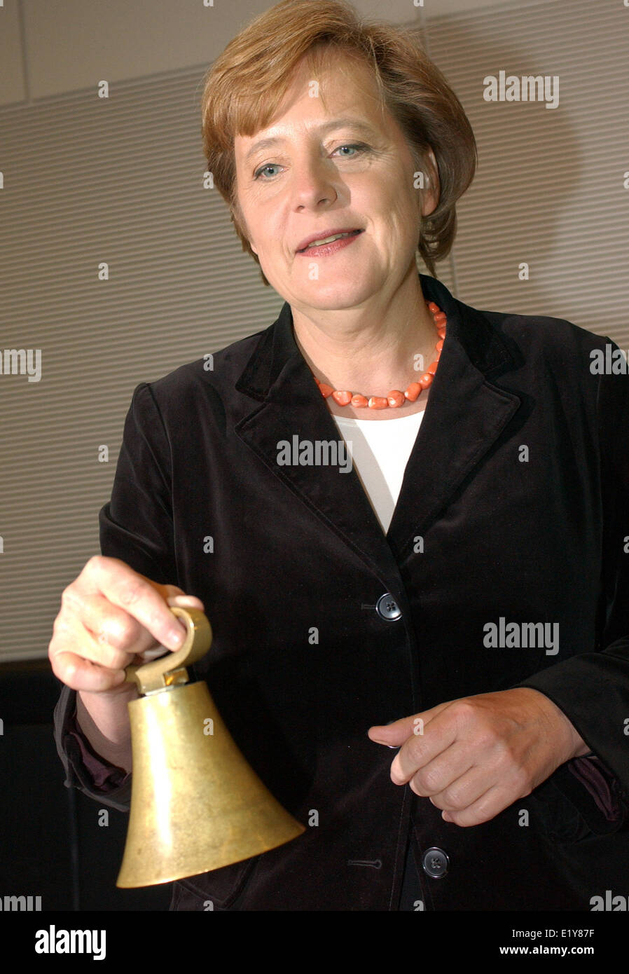Chancellor Angela Merkel  rings the bell to mark the beginning of the CDU parliamentary party meeting in Berlin - Stock Image