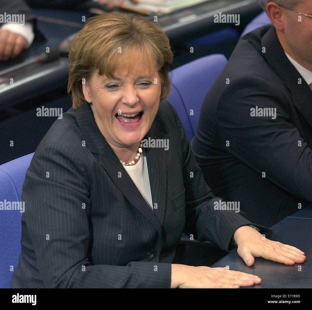 Chancellor and CDU chairwoman Angela Merkel laughs out loudly on the occasion of Norber Lammert's slip of tongue - Stock Image