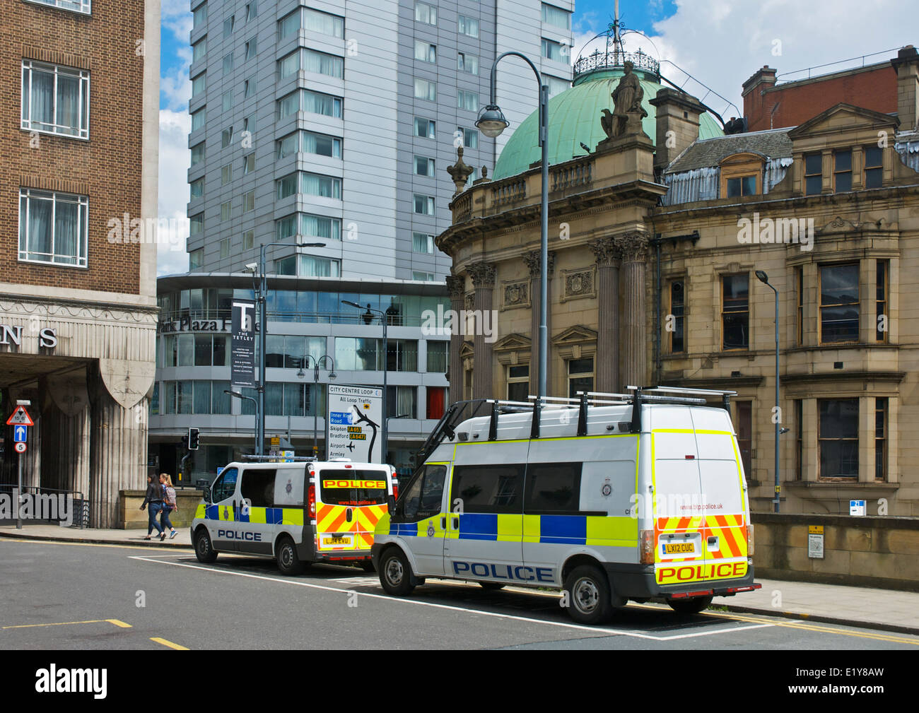 Police vans parked at Leeds City railway station, West Yorkshire, England UK - Stock Image