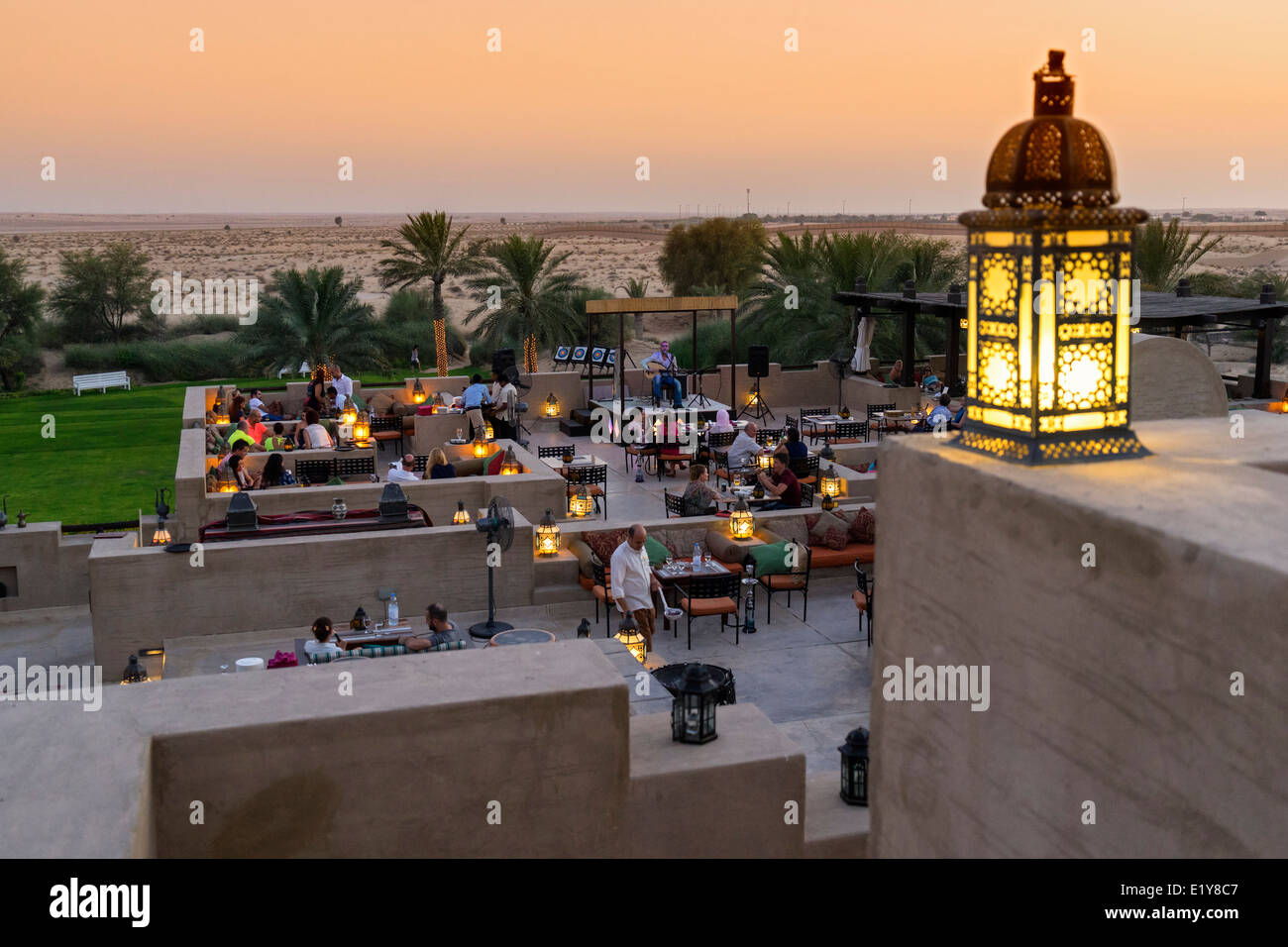 Dusk at rooftop bar at Bab al Shams desert hotel and resort in Dubai United Arab Emirates - Stock Image