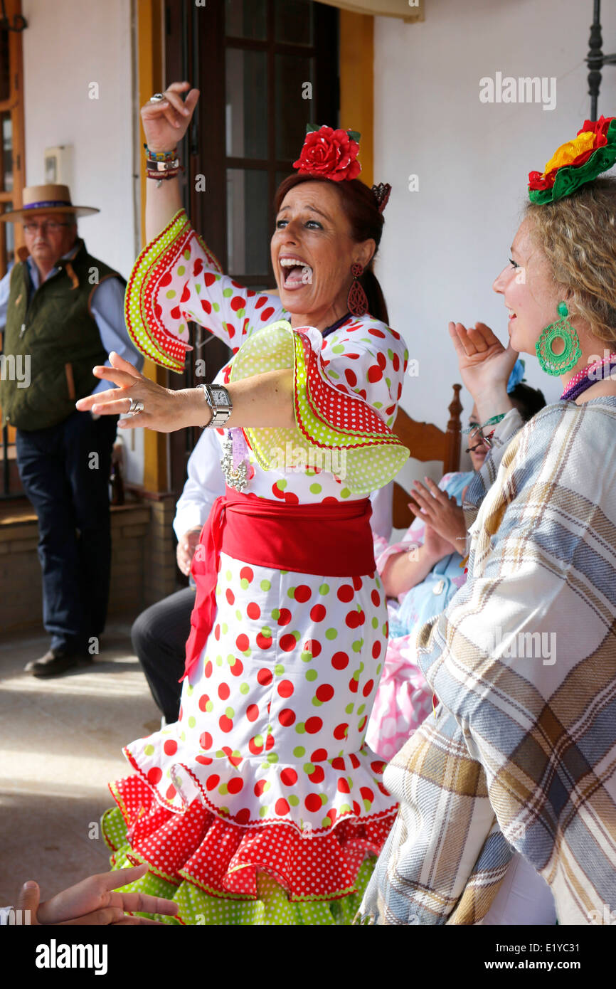 Woman dancing Andalusian style at the Rocio Romeria Catholic festival in the village of El Rocio, Southern Spain - Stock Image