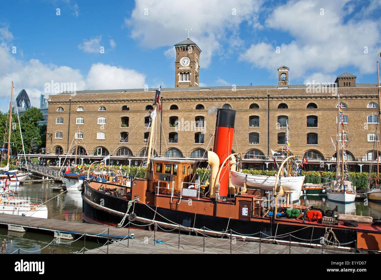 Tug boat on moorings in St Katharine Docks, Tower Hamlets, London, England, UK, Western Europe. - Stock Image