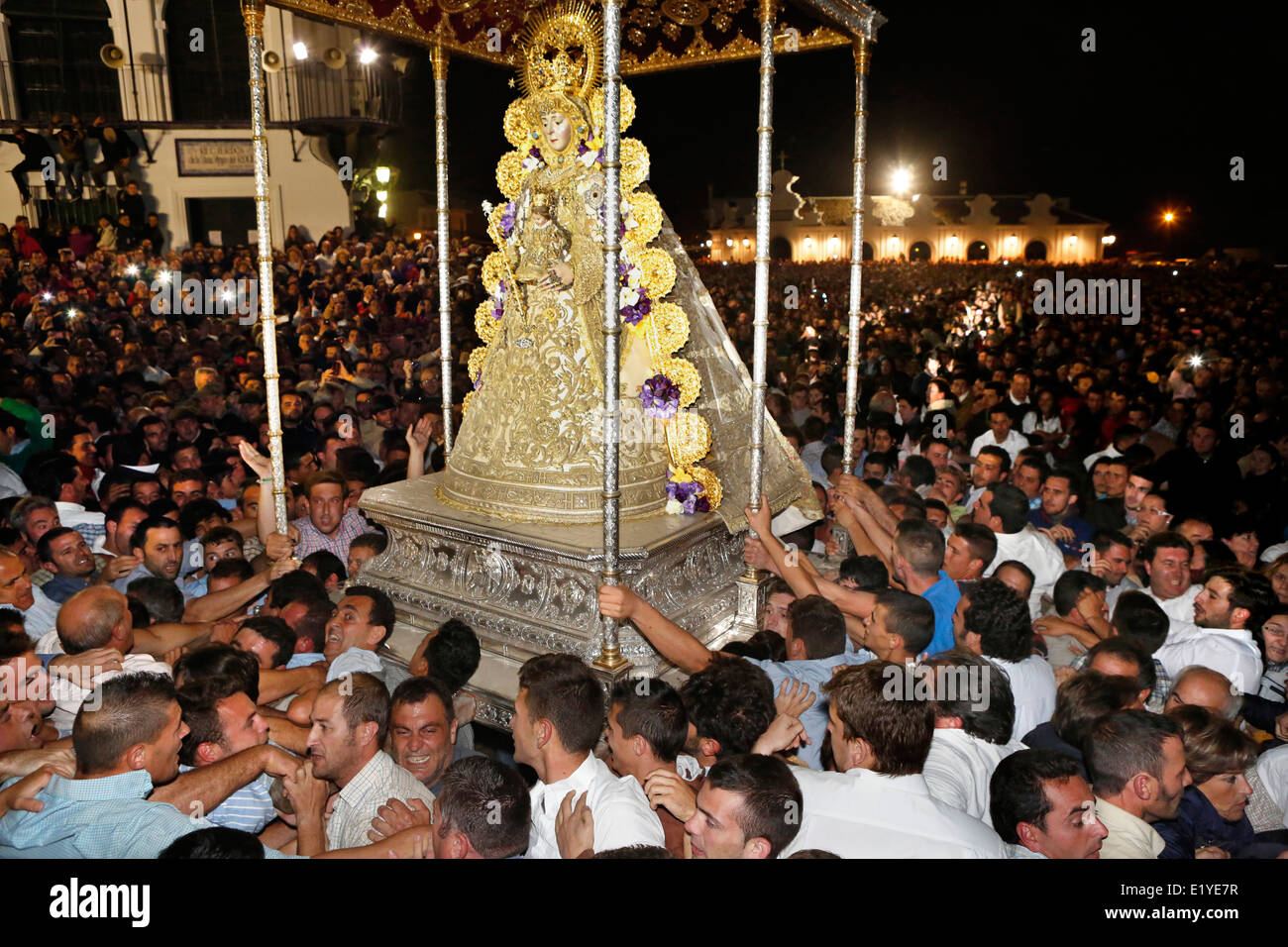Thousands gather to touch the Virgin of El Rocío during the Romeria processionin Rocio in the province of Huelva, Stock Photo
