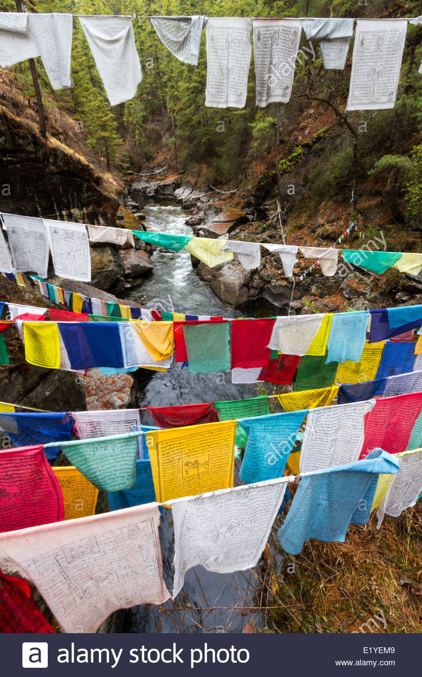 Tibetan Buddhist Prayer Flags At Buddha's Bathtub In The Bumthang Valley Of Bhutan - Stock Image