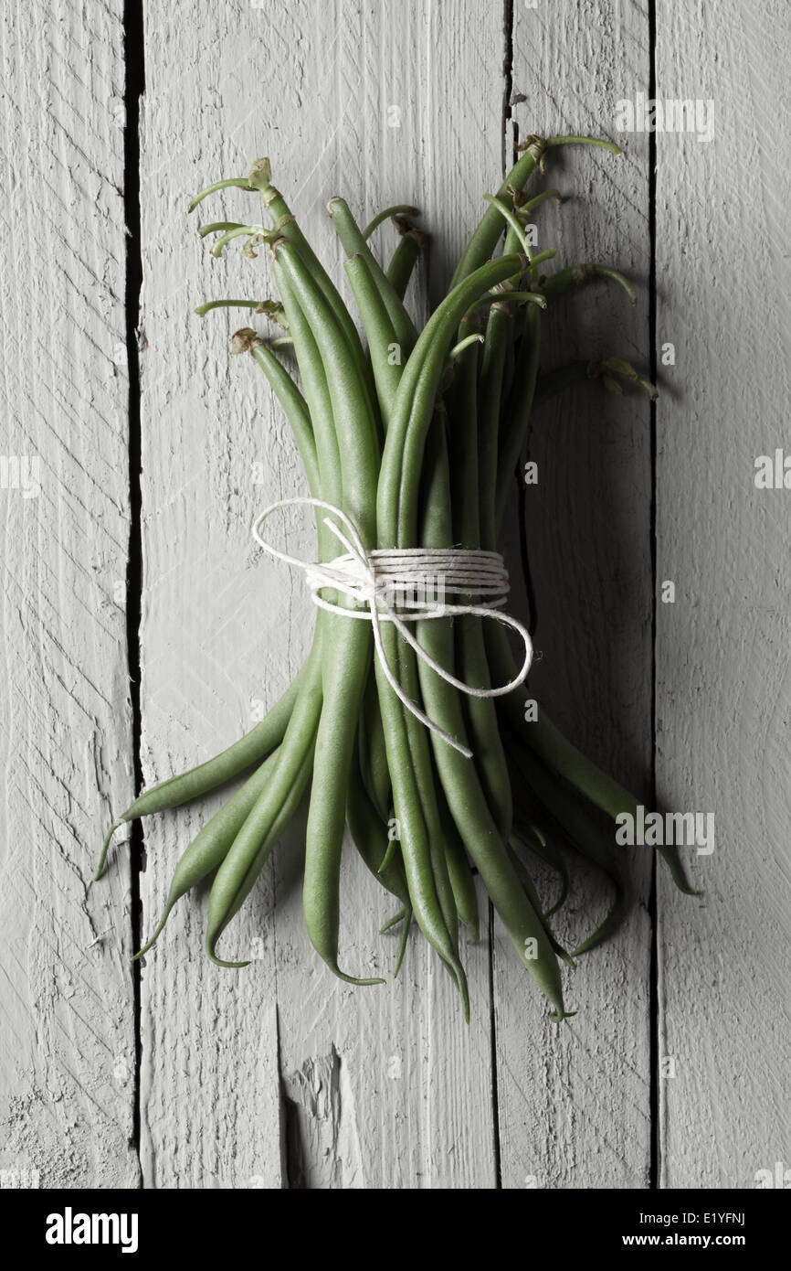 Tied Green Beans on Gray Wood - Stock Image