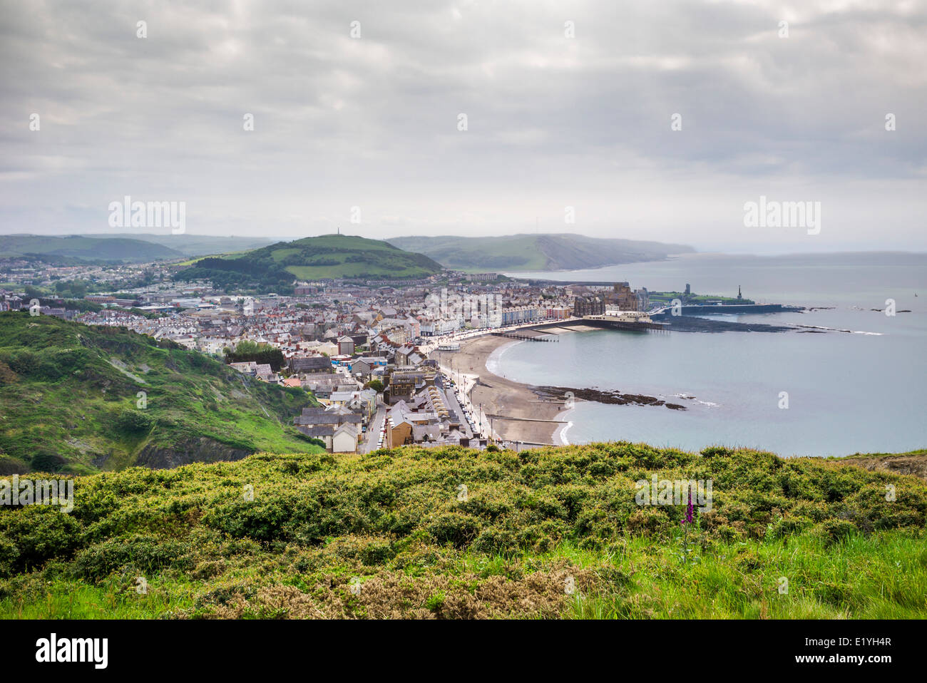 A view from the top of Constitution hill overlooking the coastal resort of Aberystwyth with sandy beach and Cardigan - Stock Image
