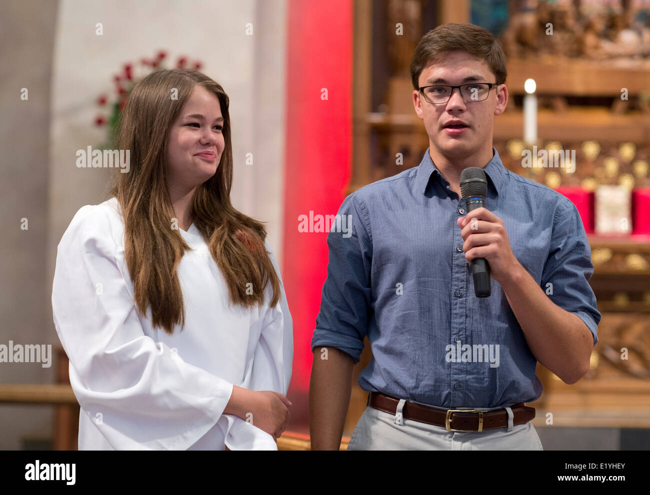 Lutheran teenager participating in the Rite of Confirmation is introduced to the congregation by her sponsor. - Stock Image