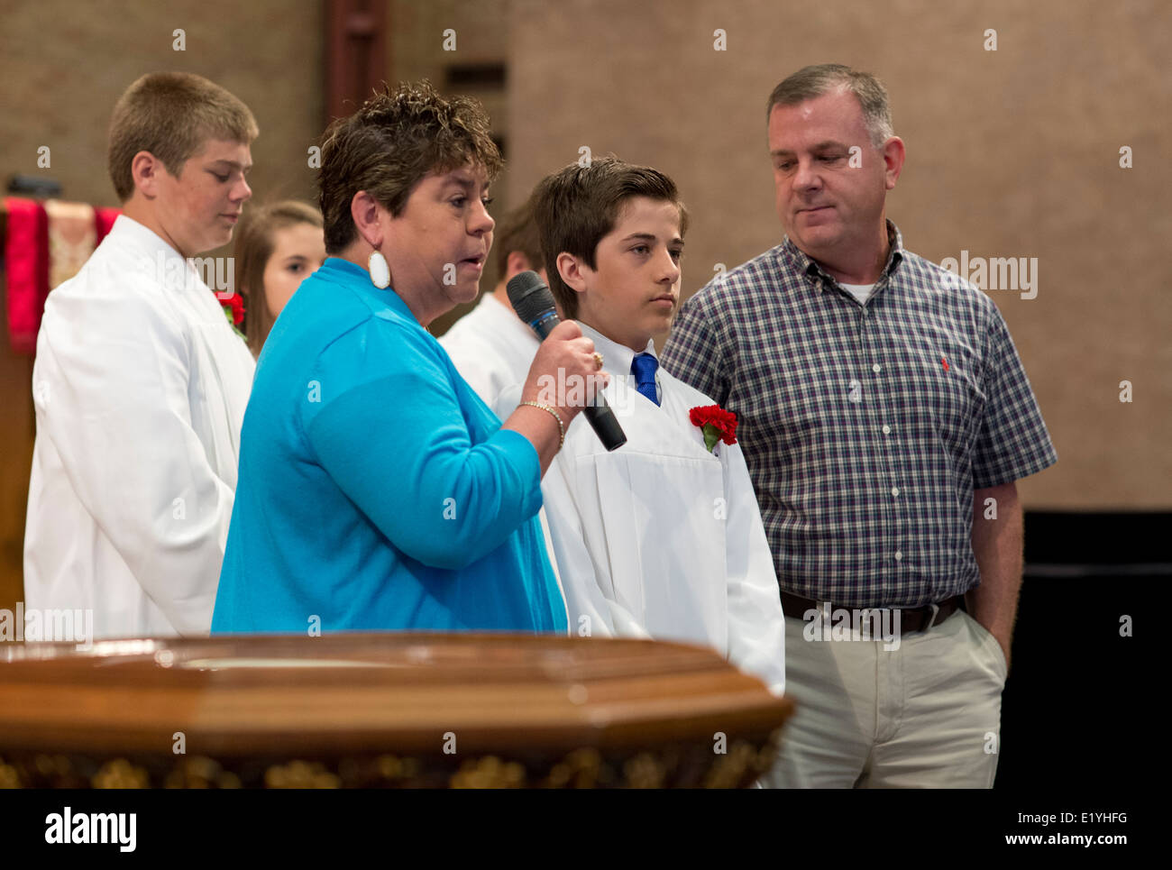 Lutheran teenager participating in the Rite of Confirmation is introduced to the congregation by his sponsor. - Stock Image