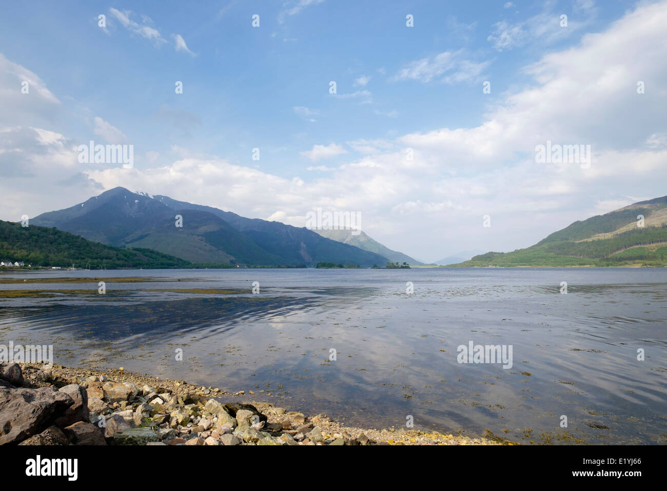 View across sea Loch Leven to mountains in Scottish Highlands at high tide in summer from Invercoe, Glencoe, Highland, - Stock Image