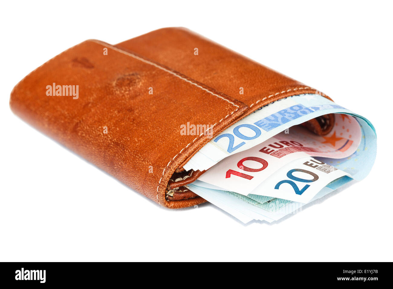 Old brown leather wallet purse stuffed full with Euros Euro notes from the Eurozone cut out and isolated on a white - Stock Image