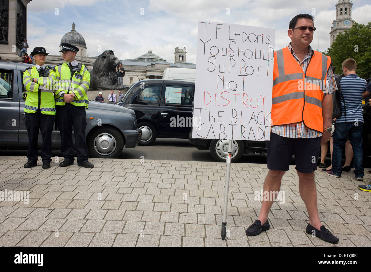 Black taxi cab drivers protest in Whitehall, central London, objecting to a new online booking and journey fare Stock Photo