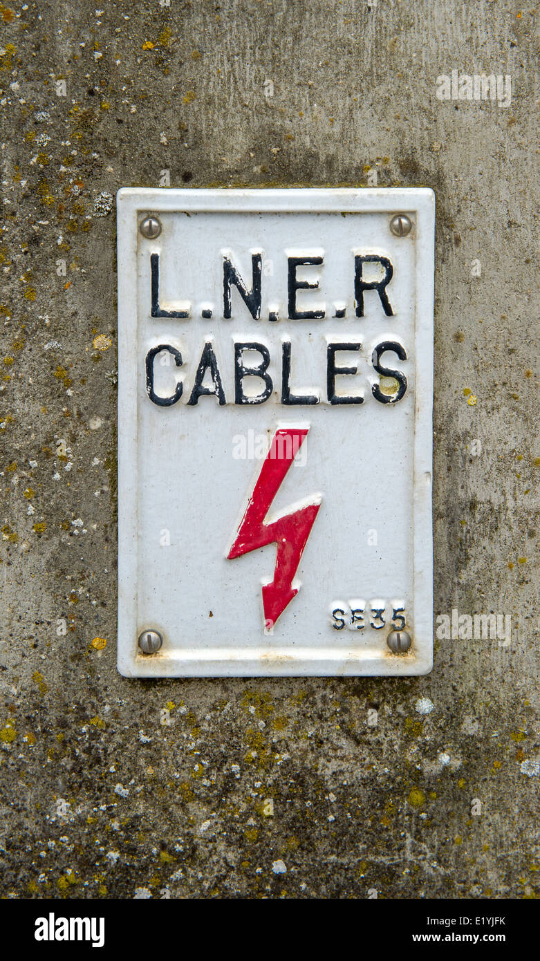 London North Eastern Railway sign of electrical cables. - Stock Image