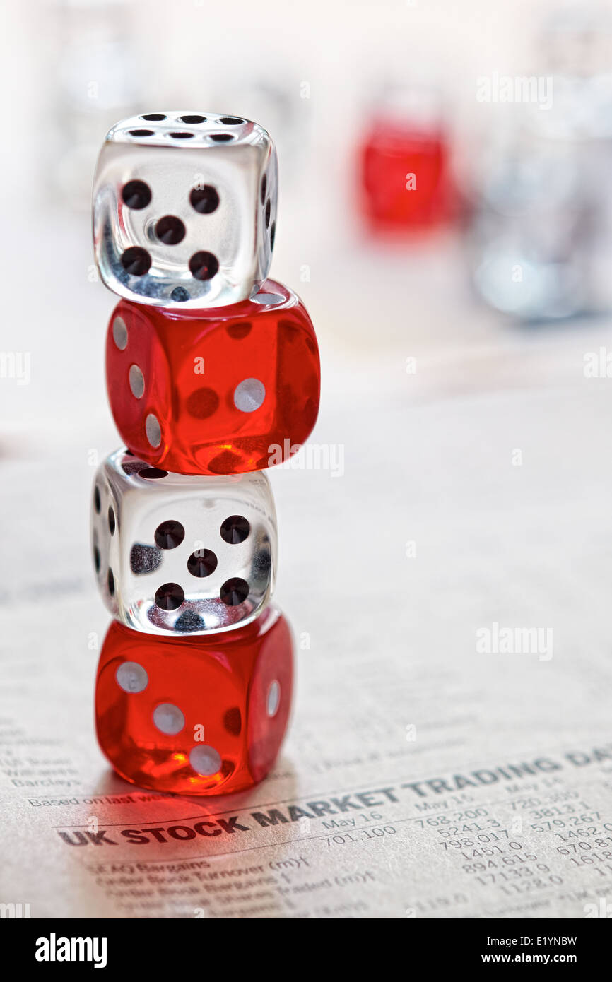 Stocks and shares Trading  Coloured dice on top of the