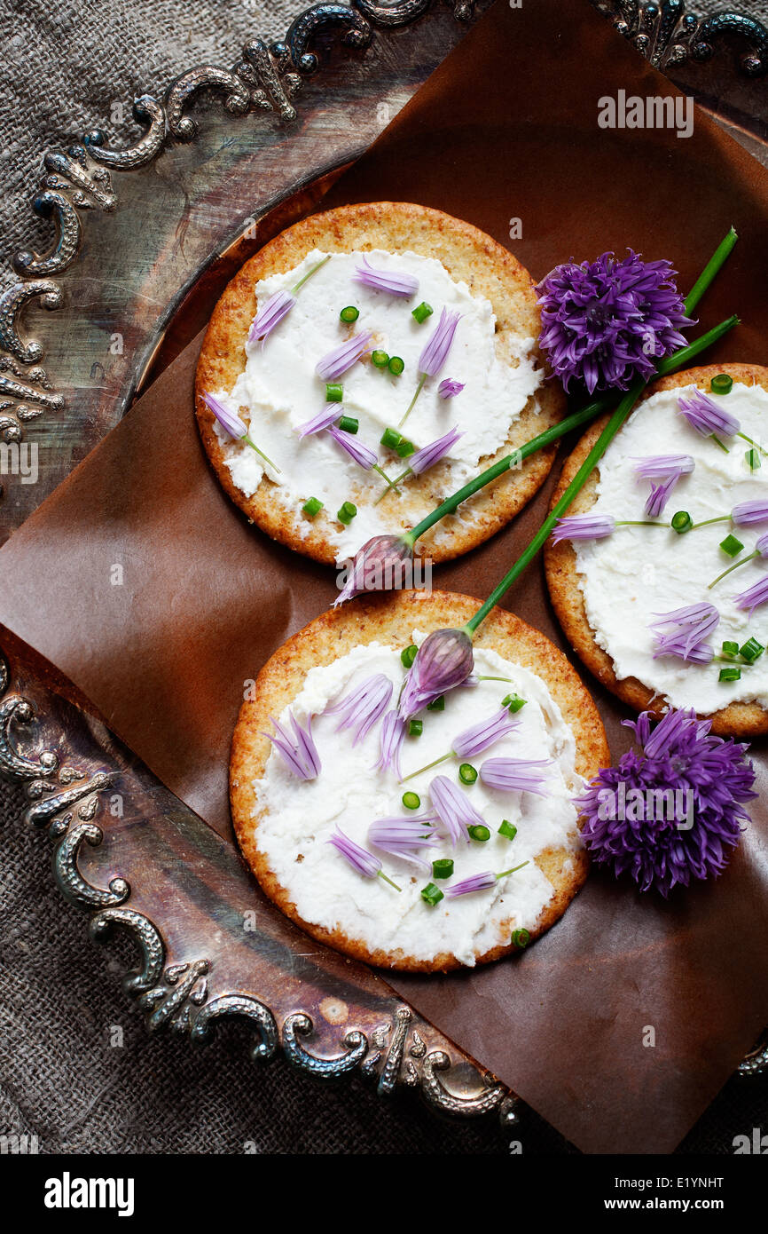 Crackers with fresh chives and cream cheese Stock Photo
