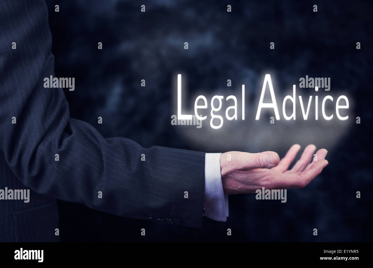 A businessman's hand holding the words, Legal Advice. - Stock Image
