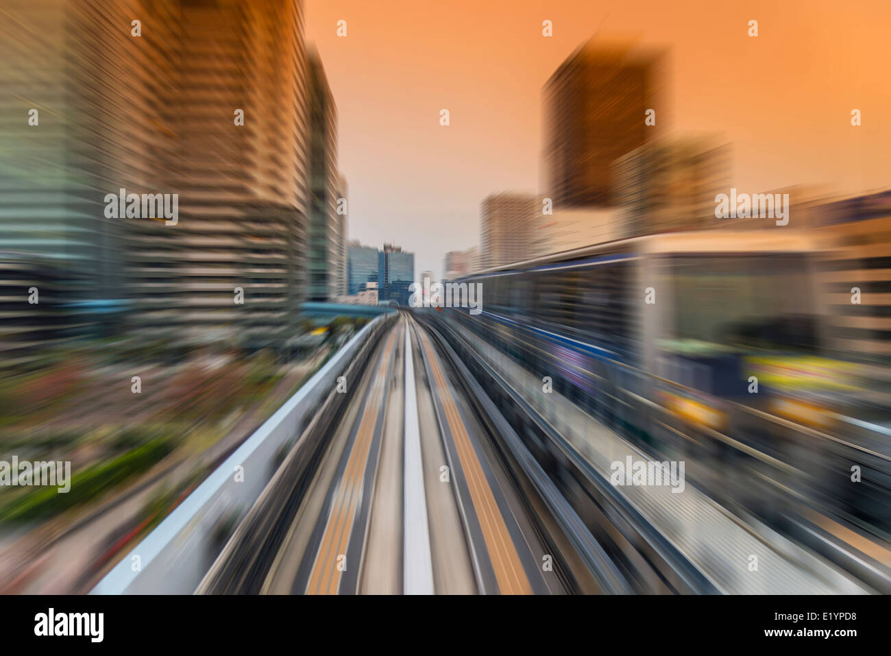 Blurred view of Yurikamome automated guideway transit train, Tokyo, Japan - Stock Image