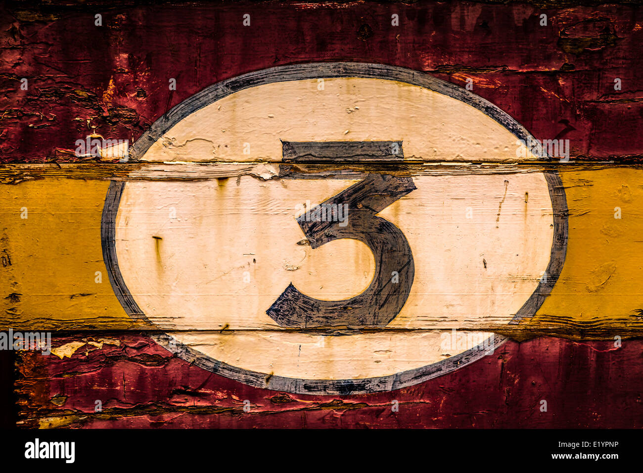 Old painted signs with numerals. Number 3 from a series of numerals. - Stock Image