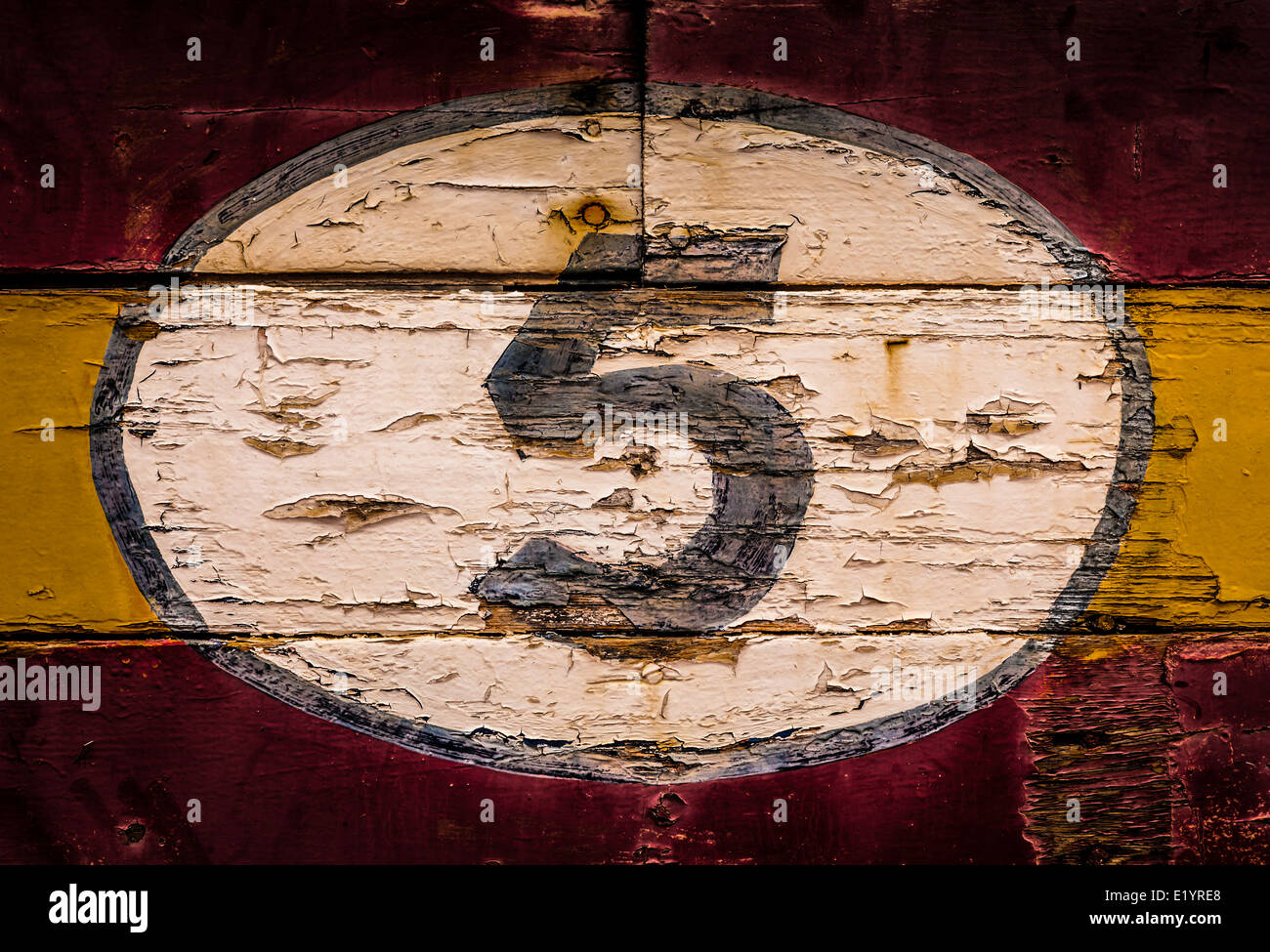 Old painted signs with numerals. Number 5 from a series of numerals. - Stock Image