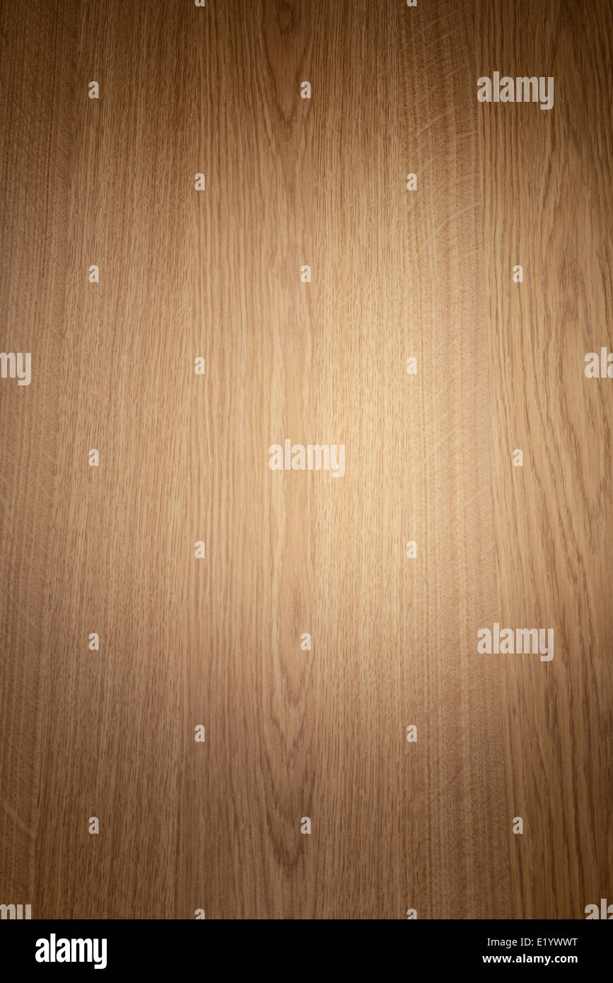 Spotlight on a wooden background - Stock Image
